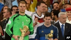Germany's goalkeeper Manuel Neuer winner of the golden glove award for best goalkeeper stands alongside golden ball winner Argentina's Lionel Messi after the World Cup final soccer match between Germany and Argentina in Rio de Janeiro, Brazil, July 13, 20