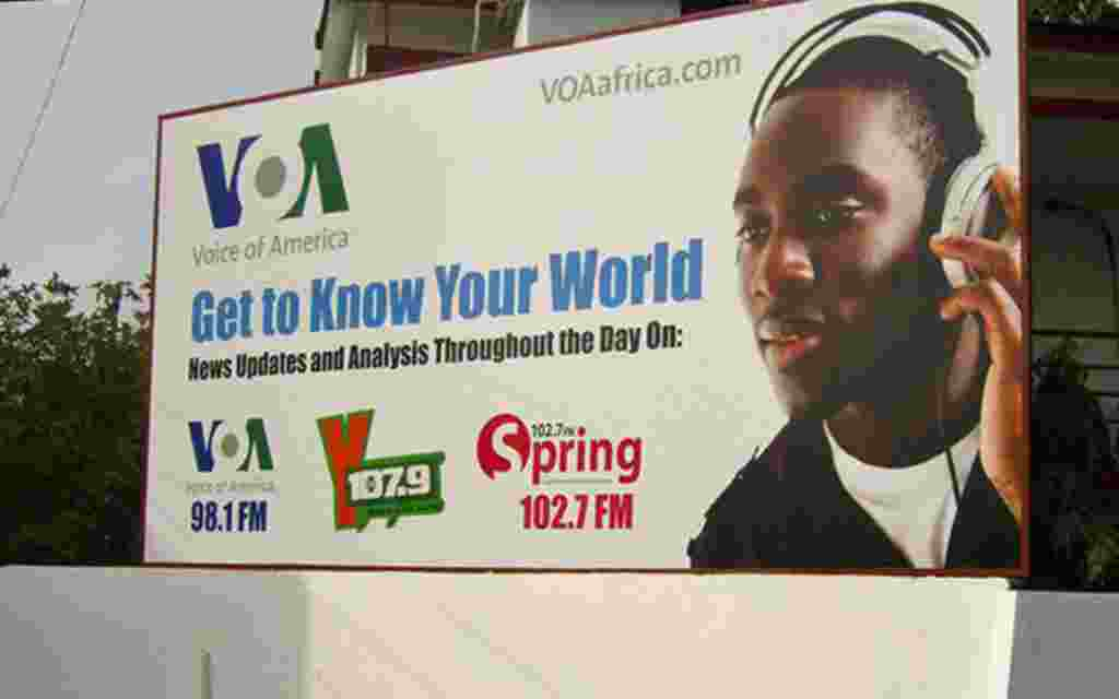 Promoting VOA and affiliate stations on a billboard in Accra, Ghana.