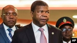 Angola's President Joao Lourenco, center, arrives for a round table event at an EU Africa summit in Abidjan, Ivory Coast, Nov. 29, 2017.