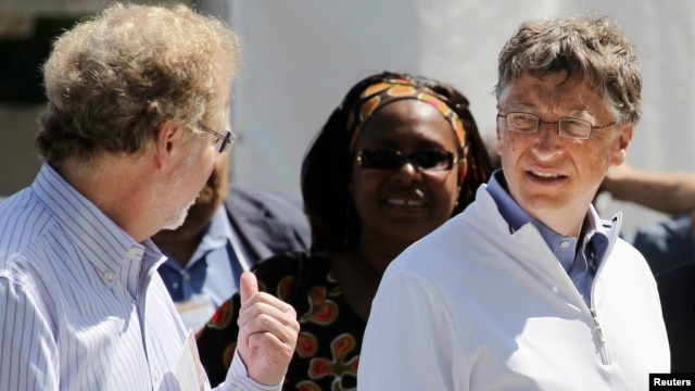 "FILE - Bill Gates (R) and former Microsoft chief technology officer and co-founder of Intellectual Ventures Nathan Myhrvold (L) speak while reviewing the displays at the ""Reinvent the Toilet Fair"" competition at the Bill and Melinda Gates Foundation."