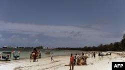 Local tourists walk at the Kenyatta public beach on August 30, 2012, in Mombasa, Kenya.