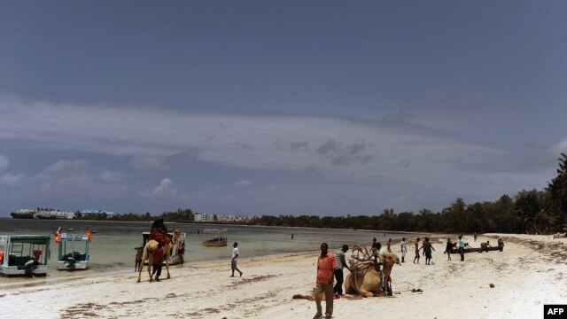 Local tourists walk at the Kenyatta public beach on August 30, 2012, in Mombasa, Kenya.