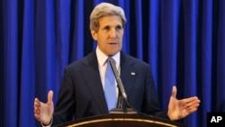 U.S. Secretary of State John Kerry speaks during a press conference at Queen Alia International Airport in Amman, Jordan, July 19, 2013.
