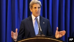 U.S. Secretary of State John Kerry speaks during a press conference at Queen Alia International Airport, July 19, 2013. Kerry says Israel and the Palestinians will meet soon in Washington to finalize an agreement on relaunching peace negotiations for the