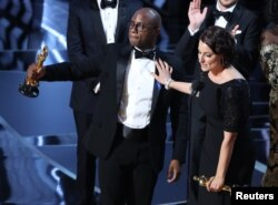 "Director Barry Jenkins and producer Adele Romanski celebrating the best picture win for ""Moonlight."""