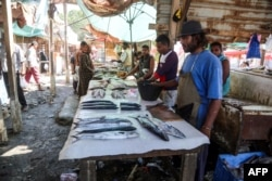 This picture taken on Dec. 14, 2018 shows a view of a fish seller's stall at a market in the Huthi-held Red Sea port city of Hodeida.
