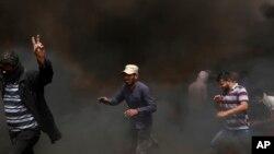 가자지구에서 시위하는 팔레스타인인들