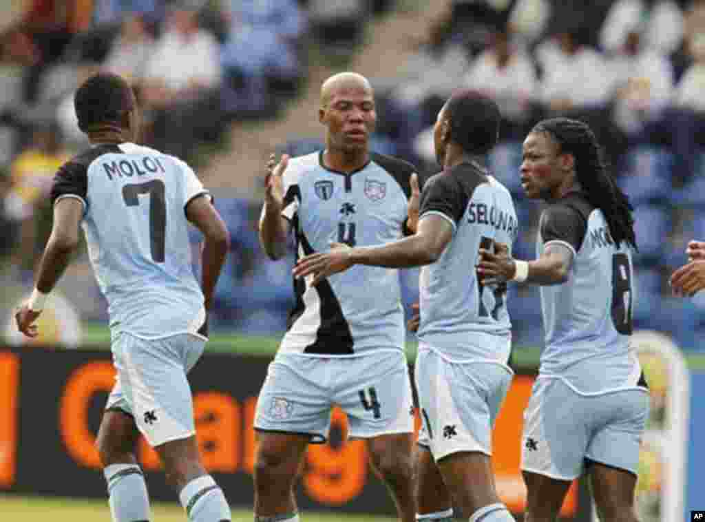 Botswana's Dipsy Selolwane (2nd R) celebrates his goal with teammates during their African Nations Cup Group D soccer match against Guinea at Franceville Stadium January 28, 2012.