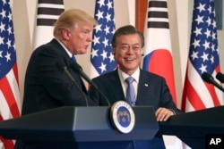 FILE - President Donald Trump, left, speaks as South Korean President Moon Jae-in looks on during a joint news conference at the Blue House in Seoul, South Korea, Tuesday, Nov. 7, 2017.