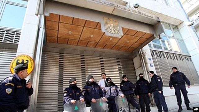 Riot police secure the entrance to the German Embassy during an anti-austerity protest in Athens, February 17, 2012.