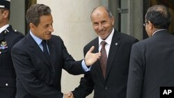 "France's President Nicolas Sarkozy (L) welcomes Mustafa Abdel Jalil (C), chairman of the Libyan National Transitional Council (NTC), and Mahmoud Jibril (R), the head of Libya's rebel National Transitional Council, prior to the opening of the ""Friends of L"