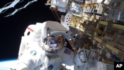 During the STS-131 mission's first spacewalk, which lasted about 6.5 hours, NASA astronaut Rick Mastracchio helped move a new 1,700-pound ammonia tank from space shuttle Discovery's cargo bay