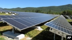 A portion of the Stafford Hill solar power project gathers energy from the sun in Rutland, Vt., on Tuesday, Sept. 15, 2015.