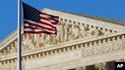 FILE - An American flag flies in front of the Supreme Court in Washington, June 27, 2012.