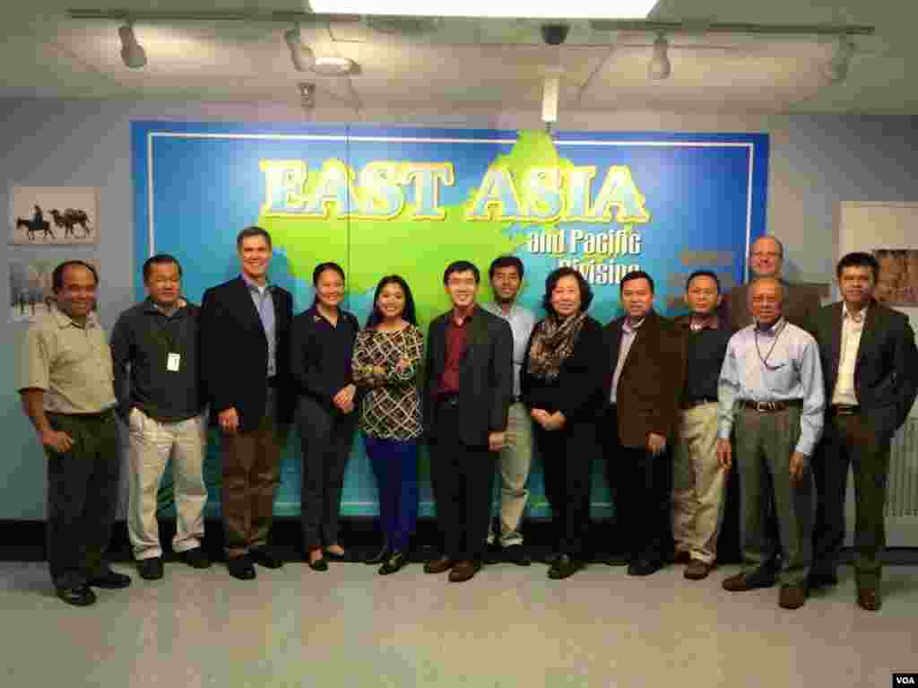 VOA Khmer team in Washington: (left to right) Reasey Poch, Pochin Choeng, Guest, Moryvan Ly, Manilene Ek, Kimseng Men, Sophat Soeung, Sarita Nuch, Khemara Sok, Sisovann Pin, Yann Ker, Chris Decherd (behind), and Sothearith Im.