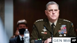 Chairman of the Joint Chiefs of Staff Gen. Mark Milley attends a Senate Armed Services Committee hearing on the conclusion of military operations in Afghanistan and plans for future counterterrorism operations, on Capitol Hill, Sept. 28, 2021.