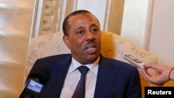 Waziri mkuu wa libya Abdullah al-Thani akizungumza na waandishi wa habari huko Abu Dhabi September 10, 2014.