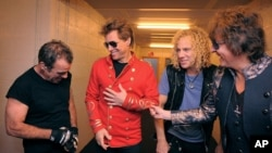 From left Tico Torres, Jon Bon Jovi, David Bryan, and Richie Sambora from US rock band Bon Jovi share a laugh backstage in Munich, June 12, 2011