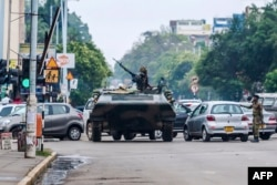 "Zimbabwe's military appeares to be in control of the country on Nov.15, 2017, as generals denied staging a coup but used state television to vow to target ""criminals"" close to President Mugabe."
