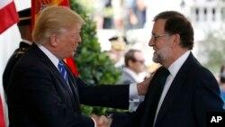 El presidente de EE.UU., Donald Trump agradeció al primer ministro español Mariano Rajoy los esfuerzos de su gobierno para buscar una solución a la crisis en Venezuela, durante un encuentro en la Casa Blanca. Sept. 26, 2017.