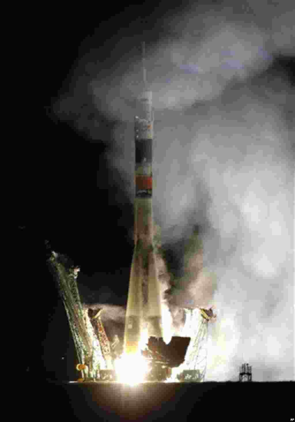 The Soyuz-FG rocket booster with Soyuz TMA-01M space ship carrying a new crew to the International Space Station, ISS, blasts off from the Russian leased Baikonur cosmodrome, Kazakhstan, early Friday, Oct. 8, 2010. The Russian rocket carries US astronaut