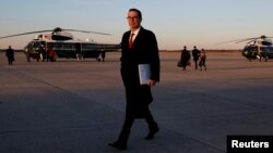U.S. Treasury Secretary Steven Mnuchin walks to his car while returning to Washington with U.S. President Donald Trump aboard Air Force One, at Joint Base Andrews, Maryland, Feb. 5, 2018.