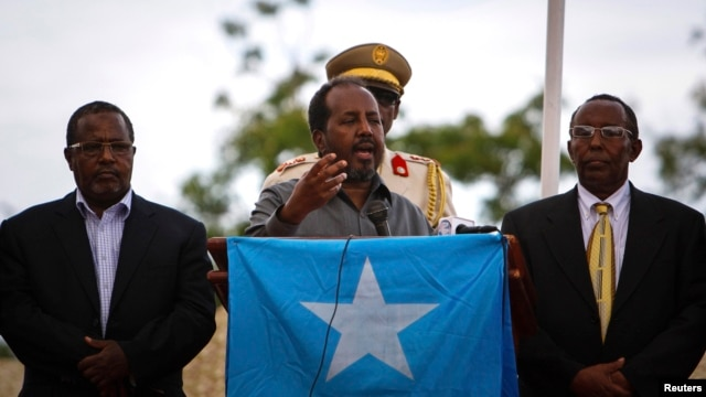 Somali President Hassan Sheikh Mohamud speaks during a military parade marking the 53rd anniversary of the Somali National Army in Mogadishu, Somalia, April 12, 2013.