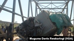 The mangled body of the truck that crashed into a passenger bus on Thursday, Dec. 11, 2014 on the Juba to Nimule highway in South Sudan. Three people were killed in the crash.