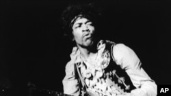 FILE - American rock guitarist Jimi Hendrix performing with The Jimi Hendrix Experience at the Monterey Pop Festival, California, USA, June 18, 1967.