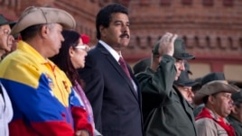Venezuela's interim President Nicolas Maduro attends a ceremony marking the Day of the National Revolutionary Militia, also called Bolivarian militias,  in Caracas, Venezuela, Saturday, Apr. 13, 2013.