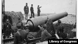 View of a gun pointed at Fort Sumter (Photograph by Samuel A. Cooley/Library of Congress)