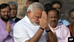 Indian Prime Minister-designate and Hindu nationalist Bharatiya Janata Party leader Narendra Modi pays his respects at Rajghat, the memorial of Mahatma Gandhi, in New Delhi, May 26, 2014.