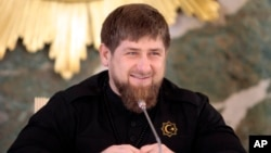 FILE - Chechen regional leader Ramzan Kadyrov speaks to journalists in Chechnya's provincial capital Grozny, Russia, Dec. 28, 2015. Kadyrov has posted a video on the Internet showing Russian opposition politician Mikhail Kasyanov in the cross-hairs of a sniper scope.