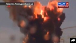 Russian booster rocket carrying three satellites crashes at a Russia-leased cosmodrome in Kazakhstan shortly after the launch, July 2, 2013.