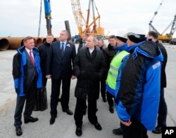 FILE - Russian President Vladimir Putin visits the construction site of the Kerch Strait bridge on Tuzla Island, Crimea, March 18, 2016. Putin traveled to Crimea to mark the second anniversary of the peninsula's seizure from Ukraine.