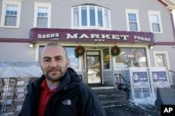 Sam Safa, of Merrimack, N.H., owner of Reeds Ferry Market, stands for a photograph outside the convenience store, Jan. 7, 2018, in Merrimack.