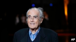 FILE - French conductor Michel Legrand arrives at the opening ceremony of the 6th Lumiere Festival, in Lyon, central France, Oct. 13, 2014.