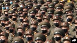 FILE - Soldiers wearing face masks to help cut coronavirus transmission rally to welcome the 8th Congress of the Workers' Party of Korea at Kim Il Sung Square in Pyongyang, North Korea, Oct 12, 2020.