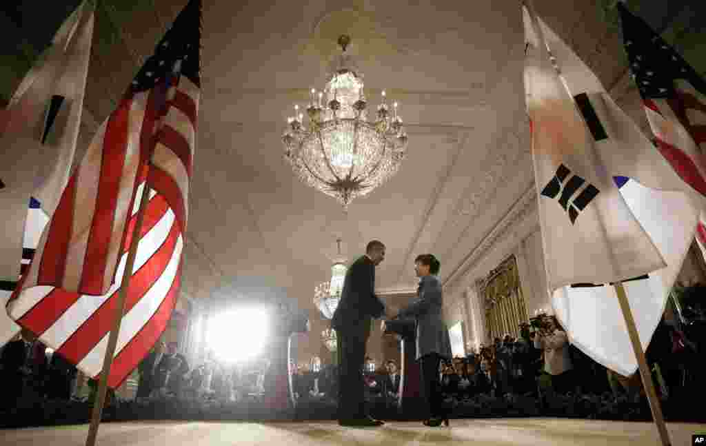President Barack Obama and South Korea President Park Geun-Hye shake hands at the end of a news conference in the East Room of the White House in Washington, May 7, 2013.