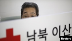 A woman who said she has family members living in North Korea waits for her turn to prepare documents for reunion at the Red Cross building in Seoul, South Korea, Sept. 8, 2015.