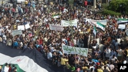 Demonstrators protest against Syria's President Bashar al-Assad in Hula, near Homs, October 27, 2011.