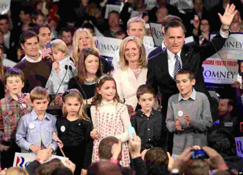 Republican candidate Mitt Romney and his family wave at supporters at his New Hampshire primary night rally, January 10, 2012. (Reuters)