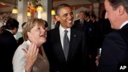美國總統奧巴馬﹑德國總理默克爾和英國首相卡梅隆最近在法國舉行八國首腦會議期間會面