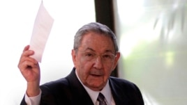 Cuba's President Raul Castro holds up the ballot of his brother Fidel, also present in the session,  for president of the National Assembly during the opening session of the parliament in Havana, Cuba, Feb. 24, 2012.