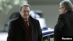Russia's Deputy Foreign Minister Mikhail Bogdanov (L) arrives at the United Nations European headquarters in Geneva, January 11, 2013.
