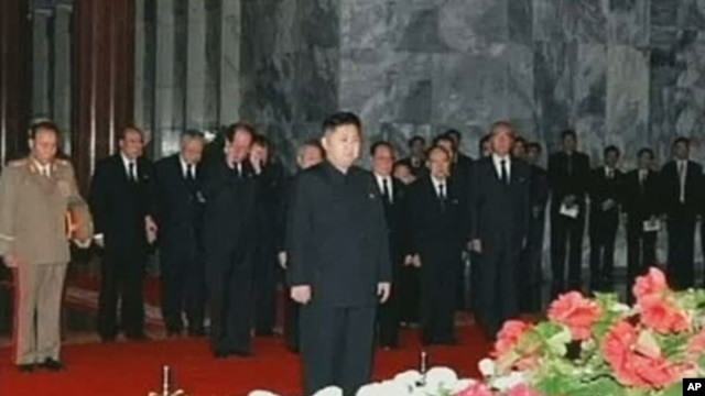 In this image made from KRT television, Kim Jong Un, center, North Korean leader Kim Jong Il's youngest known son and successor, visits the body of senior Kim in a memorial palace in Pyongyang, North Korea, December 20, 2011.