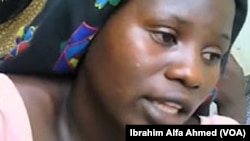 FILE - UNICEF reports a sharp increase in Boko Haram's use of females in suicide bombings in Nigeria. Shown here is an unidentified Chibok schoolgirl who was rescued.