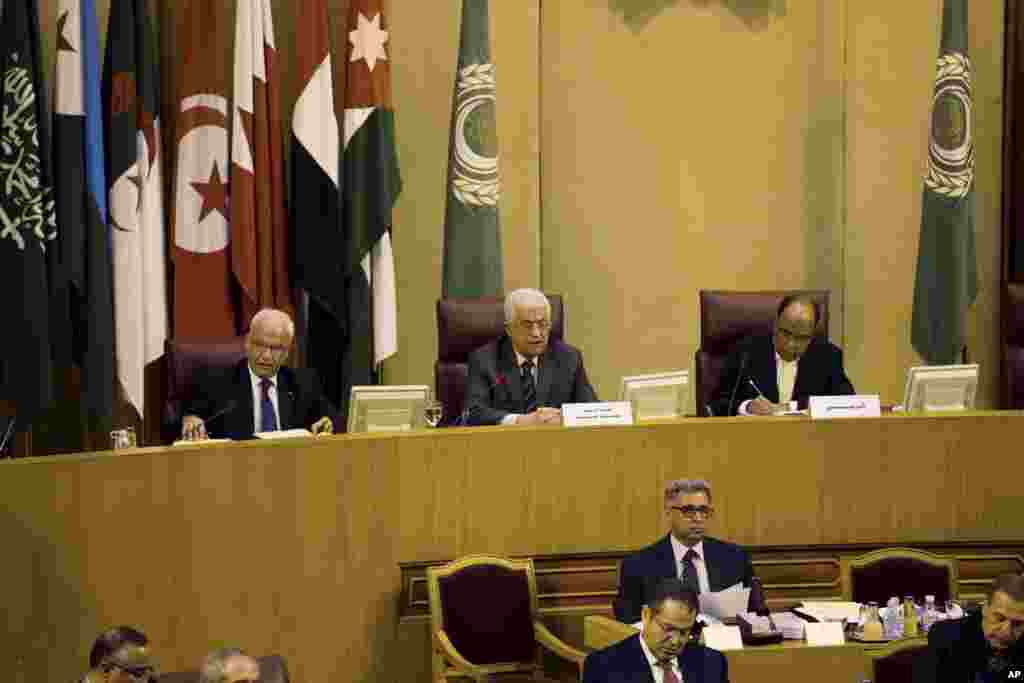 Palestinian President Mahmoud Abbas, center, speaks during an Arab foreign minister meeting at the Arab League headquarters in Cairo, Egypt, Sept. 7, 2014.