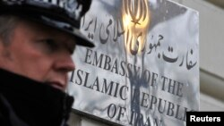 FILE - A police officer stands on duty outside the Iranian embassy in Kensington, central London December 2, 2011.
