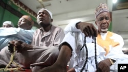 Nigeria Muslims offer prayers during Eid al-Adha which marks the end of the holy month of Hajji in Lagos, Nigeria, Oct. 15, 2013.